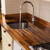 Use kitchen worktop upstands to help hide the expansion gap between a worktop and an adjacent wall.