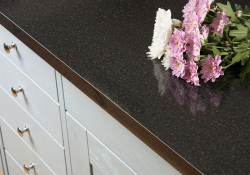 Black gloss laminate worktops have a light-reflecting surface.