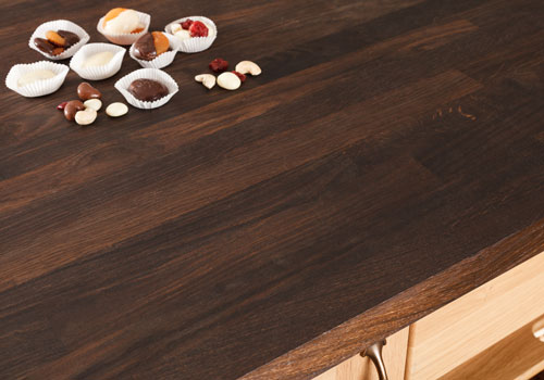 Our black oak worktops combine the natural charm of oak with a rich, almost-black colour.