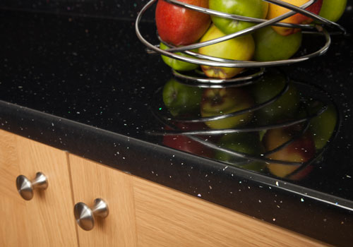 Black sparkle laminate worktops make an attractive kitchen feature.