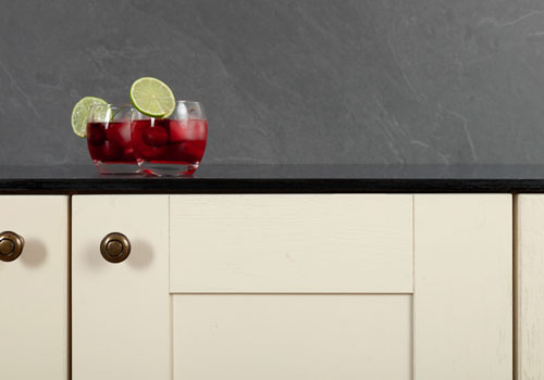 Solid laminate worktops, such as this black sparkle worktop, can be fitted to transform kitchens.
