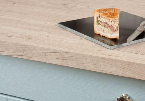 This light wood laminate worktop features a Capitol Pine effect that showcases.