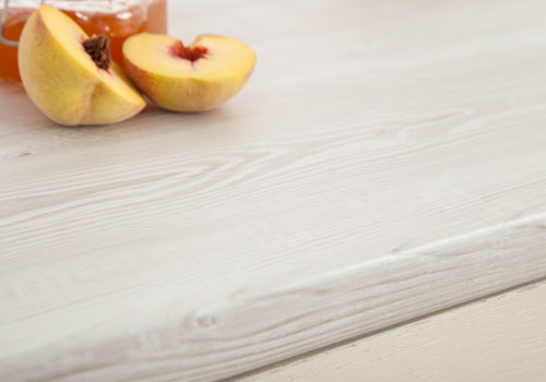 Cascina Pine white wood laminate worktops have an incredibly pale wood design.
