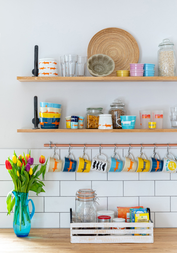 Our floating oak shelves have been installed to house a range of colourful cups and bowls.