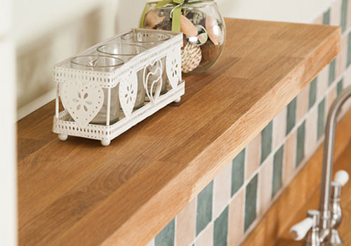 Solid oak floating shelves are a perfect companion for oak worktops.