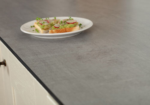 Concrete solid laminate worktops feature a realistic concrete look with a slim 12mm profile.