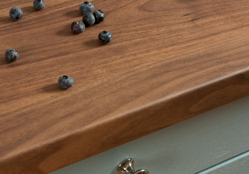 Dark walnut laminate worktop have a beautifully warm shade to match that of natural walnut.