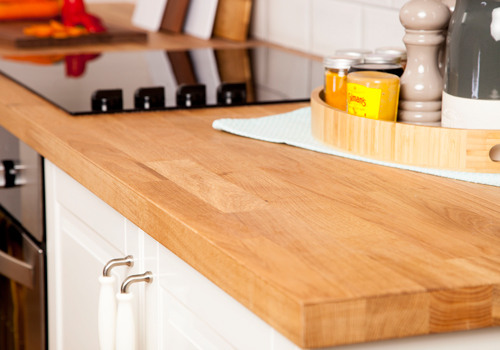 Oak veneer worktops are constructed from a layer of oak for a realistic appearance and feel of solid timber.