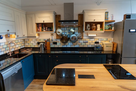 The focal point of this kitchen is the full stave oak worktop on the island.