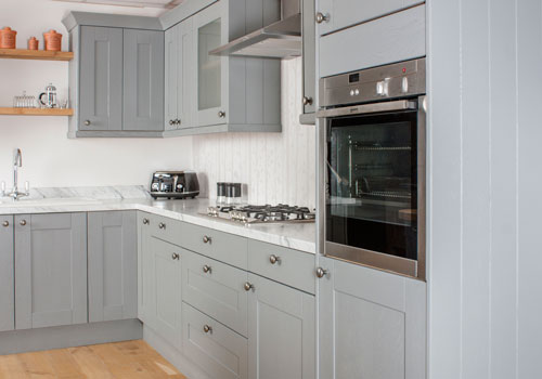 This kitchen features a white marble effect worktop that has been installed at an ergonomic height.