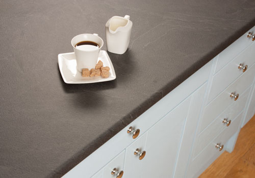 Luna Nero grey slate laminate worktops look like natural slate, but are a low-maintenance option.