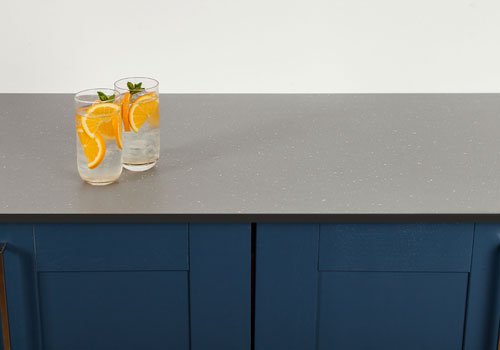 Grey sparkle solid laminate worktops feature an attractive extra matt finish.