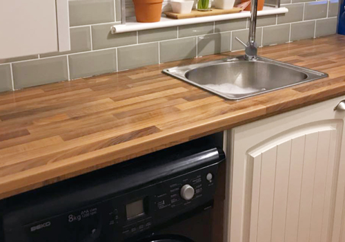 Walnut block laminate worktops are as beautiful as they are practical.