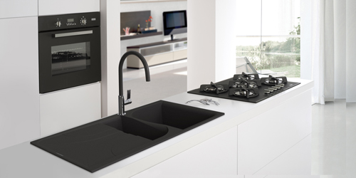 Here the Reginox black quartz single bowl sink with drainer contrasts with the white Earthstone worktop to create an ultra-contemporary aesthetic.