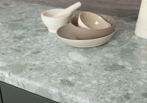 Trebbia Stone laminate worktops feature a stunning depiction of solid grey stone.