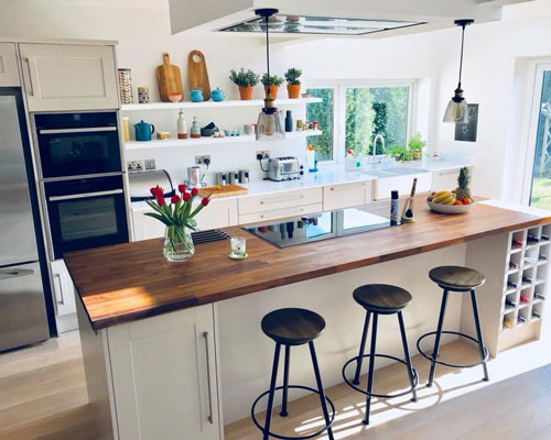 This walnut island has a hob, wine rack, seating and storage.