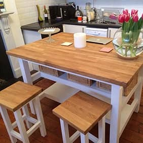 Oak worktop kitchen dining table with oak stools.