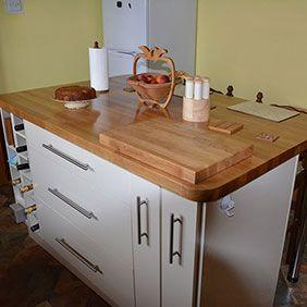 Prime Oak topped kitchen island with oak chopping board