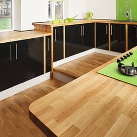 Solid oak worktops add a touch of natural beauty to this clean and contemporary kitchen.