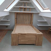 A bedframe made out of wooden worktops