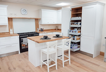 Oak worktops with a Deluxe oak kitchen island - Smethwick Kitchen Showroom, Birmingham