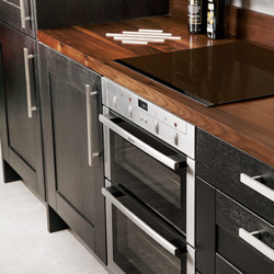 Add a touch of drama to kitchens with black cabinetry.