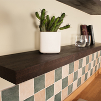 Solid black oak floating shelves are perfect for creating a modern, luxurious look