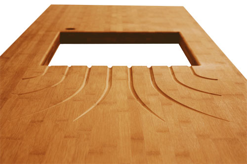 Caramel bamboo worktop with an undermounted sink and fountain drainer grooves.