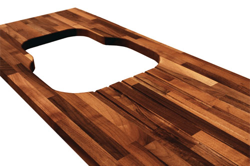 European walnut worktop with an irregular sink cutout.