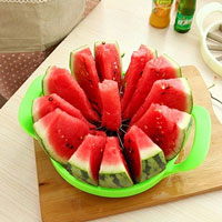 A green and stainless steel watermelon slicer