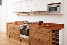 Camden showroom's Chalk Farm solid oak kitchen with solid oak floating shelves
