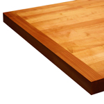 Cherry wood worktop with an end cap.