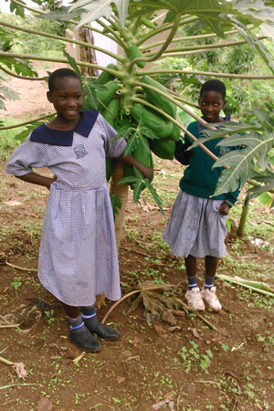 Children with Pawpaws at Butale Mixed Primary School