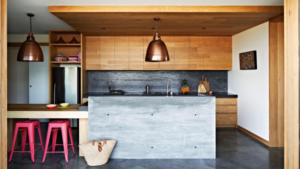 Concrete is used to create a statement kitchen island alongside a real oak surface in this modern kitchen.