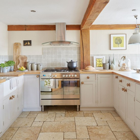 Bring a dated country kitchen into the present with a shiny stainless steel range.