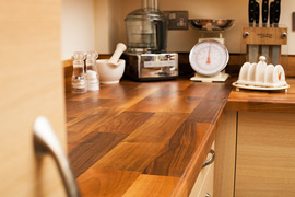 Our Deluxe walnut worktops are full of character and charm, creating a warm and inviting look in any kitchen.
