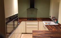 Black American walnut contrasts beautifully against light-coloured kitchen unit frontals.