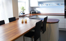 Full Stave iroko as a beautiful breakfast bar and kitchen worktop with radius corners.