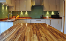 Zebrano worktops look superb, and this kitchen with island is no exception Wooden Work Surfaces.