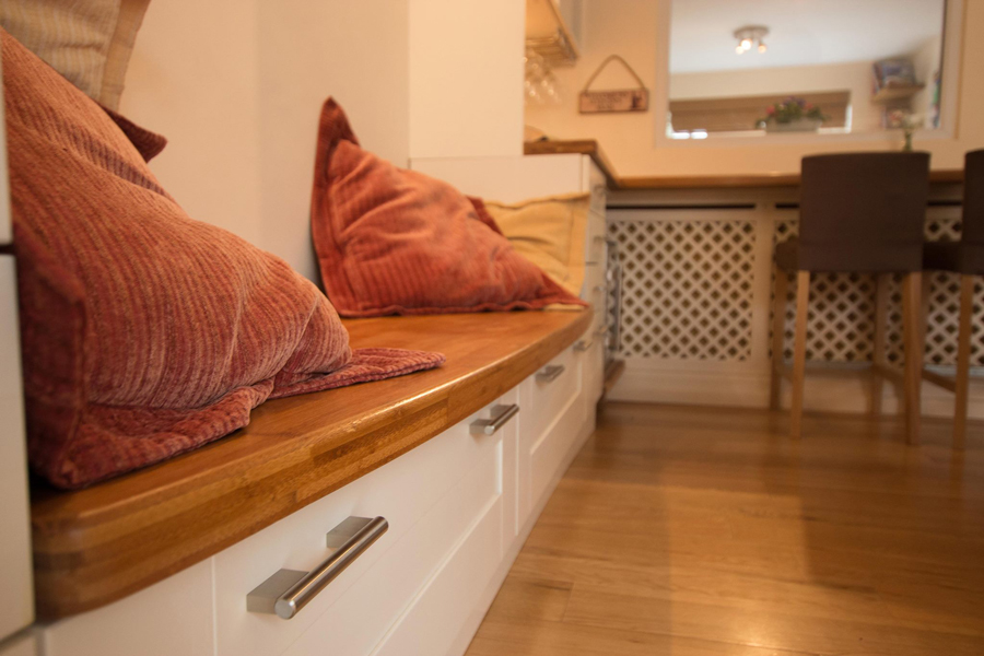 In This Kitchen, Caramel Bamboo Worktops Were Re Purposed To Create An  Elegant Bench Seating Area And Breakfast Bar.