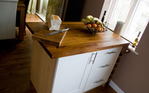 An iroko kitchen island, complete with matching iroko chopping board.
