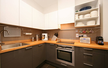 Prime beech worktops cut to size, with hob and over-mounted sink cut outs.