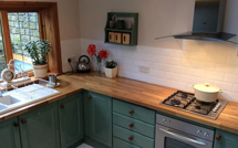 Oak worktops provided with hob and over-mounted sink cut outs.