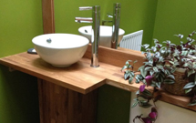 Oak worktops can be adapted to make fantastic bathroom shelving and surrounds to hide ugly pipework Wooden Work Surfaces.