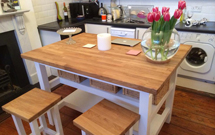 Oak used to great effect for a bespoke kitchen island and matching stools.