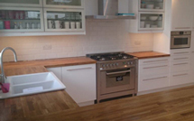 Prime oak worktops were supplied with an over-mounted sink cut out.