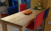 A maple worktop purposed as a spacious breakfast bar.