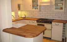 Oak worktops cut to size and with radius corners all round.