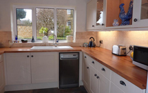 Beech worktops add a traditional aire to this contemporary kitchen.