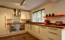 Walnut worktops look fantastic alongside painted solid wood cabinets.